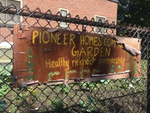 Pioneer Homes wooden sign